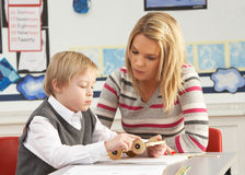 Male Primary School Pupil And Teacher Working Royalty Free Stock Photos