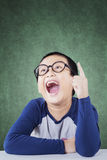 Male primary school student find idea in class Stock Images