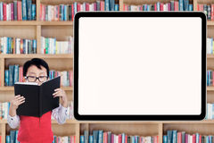 Male primary school student in library Royalty Free Stock Photo