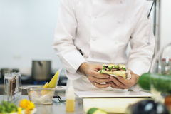 Male professional chef cooking. Stock Image
