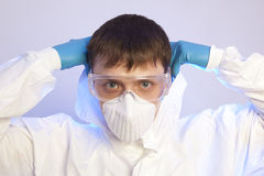 Male professional in hooded suit for bio-hazard protection. Virologist. Male professional in hooded suit for bio-hazard protection royalty free stock photo