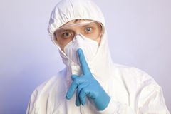 Male professional in hooded suit for bio-hazard protection. Virologist. Male professional in hooded suit for bio-hazard protection royalty free stock photography