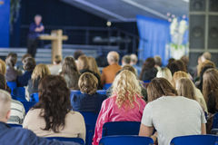 Male Professional Lecturer Speaking In front of the People. Stock Photos
