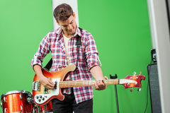 Male Professional Playing Guitar In Recording Royalty Free Stock Photo