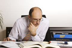 Male professional studying books Stock Photo
