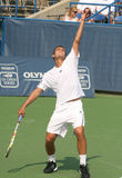 Male Professional Tennis Player Serve Stock Photo
