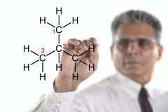 Male Professor. A chemistry professor writing on a glass board a chemical formula stock images