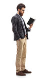 Male professor standing and reading a book Royalty Free Stock Image
