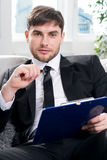Male psychologist  being ready to take notes Royalty Free Stock Images