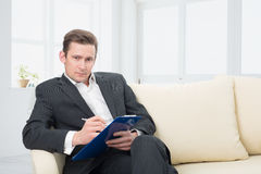 Male psychologist  being ready to take notes Royalty Free Stock Photos