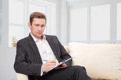 Male psychologist  being ready to take notes Stock Image