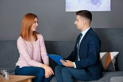 Male psychologist with client. In office Royalty Free Stock Photo