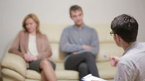 Male psychologist helping worried young couple. family therapy. angry people stock video footage