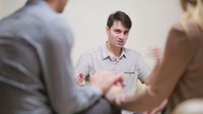 Male psychologist helping worried young couple. family therapy. angry people stock footage