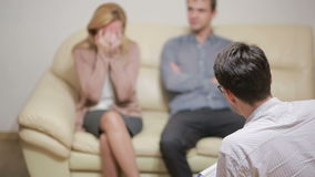 Male psychologist helping worried young couple. family therapy. angry people stock video