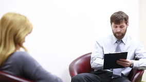 Male psychologist and his female patient during therapy stock footage