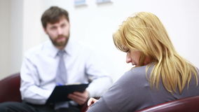 Male psychologist and his female patient during therapy stock video footage