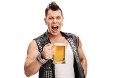 Male punk in an old jacket holding a pint of beer Stock Image