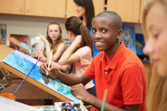 Male Pupil In High School Art Class. Looking At Camera Smiling royalty free stock images