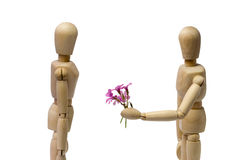 Male puppet brings woman some flowers Stock Images