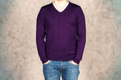 Male in purple shirt on concrete Stock Image