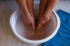 Free Male Put Hands And Feet In Bath With Hot Water And Baking Soda At Home. Homemade Bath Soak For Dry Feet Skin Stock Photo - 197460470