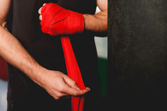 Male puts on boxing bandages Royalty Free Stock Image