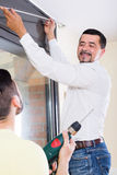 Male putting corbel at kitchen royalty free stock photos