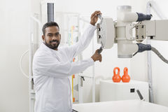 Male Radiologist Operating X-ray Machine In Hospital Royalty Free Stock Image
