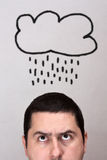 Male with rain cloud Royalty Free Stock Photo