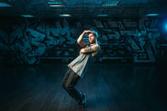 Male rapper in dance studio, rap performer. Modern urban dancing style Royalty Free Stock Photo