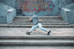 Male rapper posing on the street, urban dancing. Modern dance style Royalty Free Stock Image