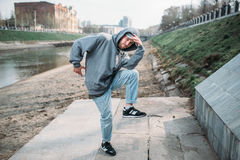 Male rapper posing on the street, urban dancing Royalty Free Stock Photo