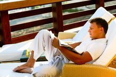 Male reading a book Stock Images