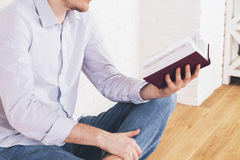 Male reading book side Stock Image