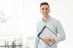 Male real estate agent with clipboard. Indoors stock photos
