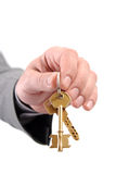 Male real estate executive hand holding two keys. Stock Photography
