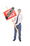 Male realtor holding a sold sign Stock Photos