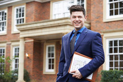 Male Realtor Standing Outside Residential Property Stock Photos