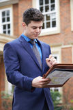 Male Realtor Standing Outside Residential Property Royalty Free Stock Photos