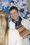 Male Receiving Christmas Gift From Woman Royalty Free Stock Image