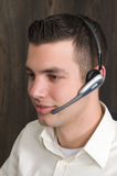 Male receptionist. Working at a helpdesk in an office Royalty Free Stock Image