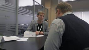 Male recruiter communicates with the job seeker during hiring in Hi-Tech Park Minsk, Belarus 11.24.18