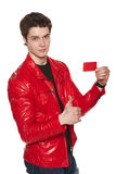Male in red jacket showing blank credit card Stock Photos