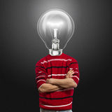 Male in red and lamp-head. Have got an idea Royalty Free Stock Photography