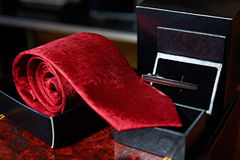 Male red tie and metal clip Stock Photo