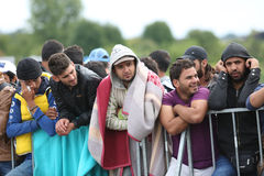 Male refugees lined up at slovenian border Stock Photos