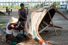 Male repair traditional boat. Royalty Free Stock Photo