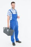 Male repairman carrying toolbox Royalty Free Stock Photos