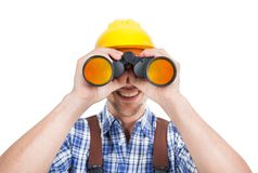 Male repairman looking through binoculars. Full length of young male repairman looking through binoculars over white background Stock Photography